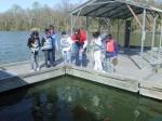 Students try catching crabs using the baited hand line method.